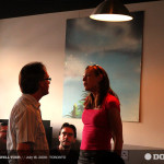 Marc Emery chats with lady in pink