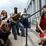 Jodie waits for Marc Emery on steps of freedom in Windsor 12-08-2014