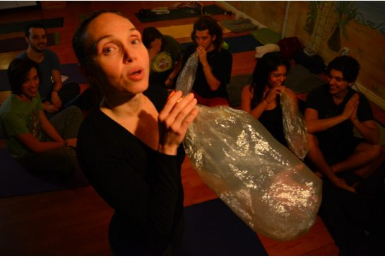 Yoga teacher Lu Pancini uses a vaporizer at the start of her ganja yoga class on Bloor St. W. // PAUL IRISH FOR THE TORONTO STAR