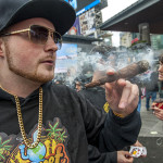A man enjoys a cone blunt joint during the 420 rally at Yonge-Dundas Square.
