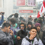 The crowd gets smoky at 4:20pm during the 420 rally at Yonge-Dundas Square.