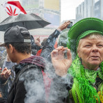A woman enjoys a joint during the 420 rally at Yonge-Dundas Square.
