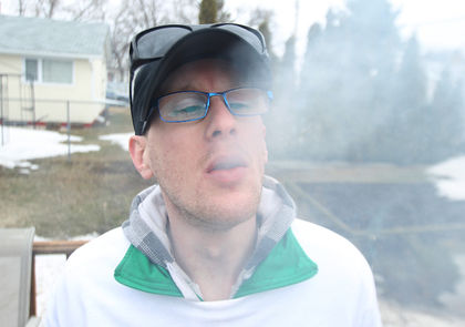 Medical marijuana user smokes in Winnipeg