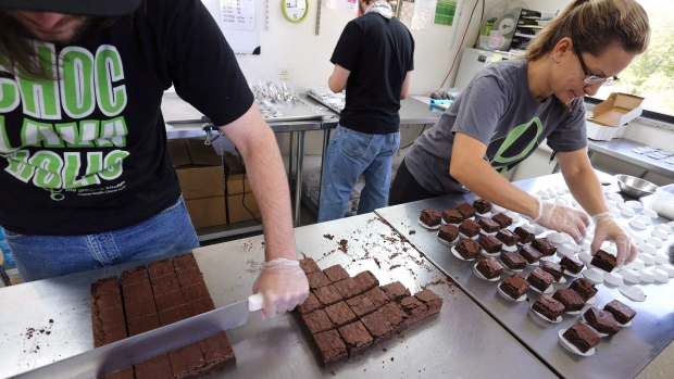Pot-infused brownies are divided and packaged at The Growing Kitchen, in Boulder, Colo. in September 2014. The Supreme Court of Canada on Thursday said medical marijuana can include products other than dried pot, such as cannabis-infused cookies brownies, oils and tea. (Brennan Linsley/Associated Press)