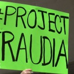 Project Fraudia sign protest