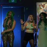high five girls passionate karaoke performance